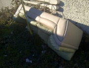 Couch dumped on the side of the road